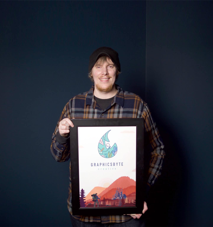 Mark Sheldon Boehly holding Graphicsbyte Creative Poster