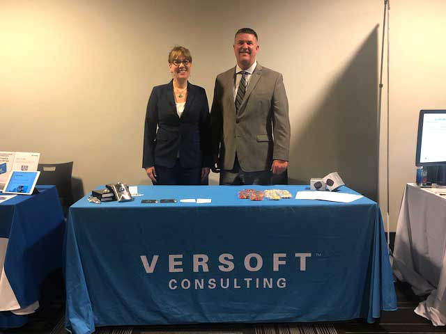 Steve Everley and Verity Larson owners of Versoft Consulting at tradeshow - website and brand by Graphicsbyte Creative - Mark Sheldon Boehly
